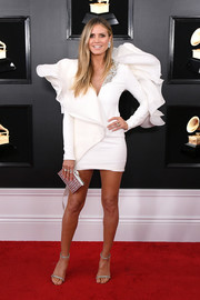 Heidi Klum pulled her look together with a metallic silver clutch.