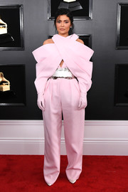 Kylie Jenner looked fashion-forward in an oversized pink jumpsuit by Balmain Couture at the 2019 Grammys.