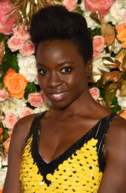 Danai Gurira wore her natural curls with a pompadour top at the Obie Awards.