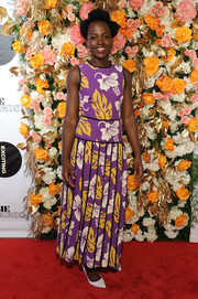 Lupita Nyong'o was tropical-chic in a floral maxi dress by Prada at the Obie Awards.