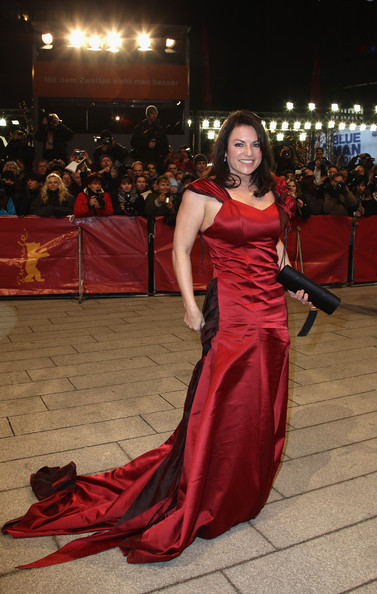 Christine Neubauer brought the drama and romance in this gorgeous crimson evening gown.