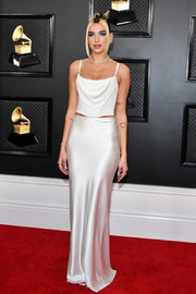 Dua Lipa completed her minimalist-chic look with a long white satin skirt, also by Alexander Wang.