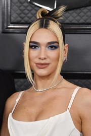 Dua Lipa rocked a sculpted top knot at the 2020 Grammys.