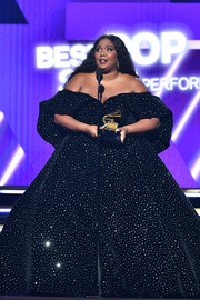 Lizzo was a vision in a crystal-studded black off-the-shoulder gown by Christian Siriano while accepting her Grammy award.