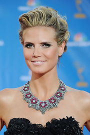 Heidi Klum keeps emphasis on her dramatic eyes with pale pink lipstick.