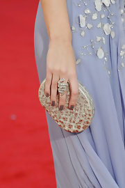 Emily Blunt paired her elegant lilac dress with a sparkling snake ring that wrapped around her finger.