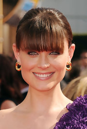 Emily Deschanel showed off her sleek bangs and classic bun while hitting the Emmy Awards.