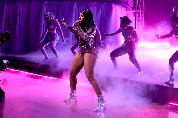 Megan Thee Stallion teamed silver lace-up boots with a matching bodysuit for her performance at the 2021 Grammys.