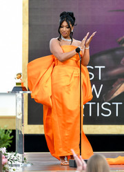Megan Thee Stallion looked regal at the 2021 Grammys in a strapless orange gown with an oversized bow at the back.