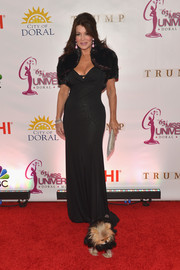 Lisa Vanderpump flaunted her hourglass figure in a slinky black gown during the Miss Universe Pageant.
