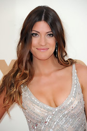 Jennifer Carpenter kept her long tresses natural for the 63rd Emmys. Her look can be recreated by making a center part and adding a few random waves with a large-barreled curling iron and tousling hair with fingers.