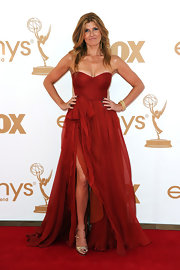 Connie was red hot at the Emmys in a strapless dress with draped chiffon detailing and a thigh-high split. She accessorized the look with gold peep-toe heels.