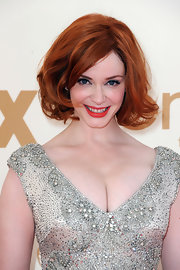 Christina Hendricks glammed up her classic bob for the 63rd Emmys. Added layers and lots of backcombing created loads of volume and movement.