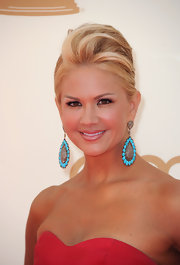 Nancy O'Dell played with lots of color, but to keep her look from being over the top, she opted for barely-there lip color. She used a creamy pink-beige shade with a subtle, pearlescent finish.