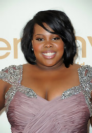 At the 63rd Emmys, Amber Riley wore a pair of cushion cut diamond drop earring set in platinum.