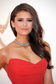 Nina Dobrev wore a glittering diamond choker necklace at the 63rd Annual Primetime Emmy Awards.