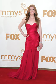 Mireille accessorized her red gown with a silver crystal front long 'Lana' clutch.
