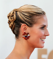 Heidi Klum wore a cool, twisted updo to the 63rd Emmys. Her hair was swept back in sections and pinned at the back of her head. Next, one-inch pieces were twisted, looped and secured with bobby pins. A generous misting of strong-hold hairspray finished the look.