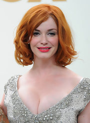 Christina Hendricks' look for the 63rd Emmys was perfected by the addition of classic red lips. She chose a shade with a warm undertone to complement her creamy skin and copper hair.  To recreate her look, we recommend a product like Covergirl LipPerfection Lipcolor in Hot.