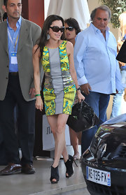 Michelle Yeoh made a statement when she arrived at her hotel in Cannes. Her spring 2010 dress screamed for attention.
