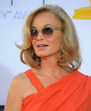 Jessica Lange kept cool, wearing light rectangular sunglasses on the Emmy red carpet.