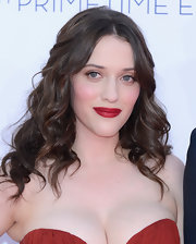 Kat Dennings pulled back her cascade of curls with a thin jewel-adorned headband.