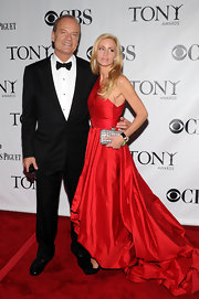 Camille Grammer paired her red evening gown with a textured box clutch.