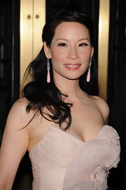 Lucy Lui looked stunning in her soft pink dress. She paired her tear drop earrings with a half up half down hairdo.