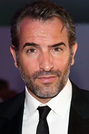 Jean Dujardin showed off his striking features with a short 'salt and pepper' hairstyle.