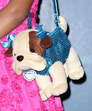 The actress carried one of her signature puppy purses on the red carpet.