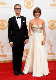 Lisa Rinna's white strapless frock looked romantic and girly on the red carpet.