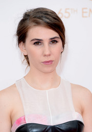 Zosia Mamet kept her look simple and natural with a soft makeup palette and an effortless pinned updo.
