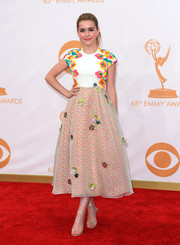 Kiernan kept her red carpet look playful and flirty with a floral dress with adorable appliques.