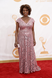 Alfre shined in a shimmering pink V-neck gown with lace embroidery and a scalloped hemline.