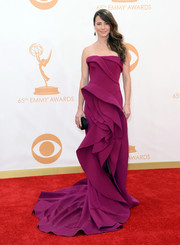 Linda Cardellini's strapless magenta gown featured architectural folds and a flared skirt for a very structured red carpet look.