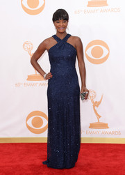 Sufe's sparkled in a high V-neck, navy, floor-length gown.