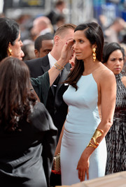 Padma Lakshmi looked like a modern-day goddess wearing this Robert Lee Morris gold cutout cuff with her pastel-blue cutout dress at the Emmys.