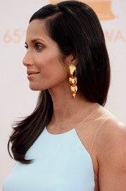 Padma Lakshmi's Robert Lee Morris gold dangle earrings looked gorgeous against her baby-blue gown at the Emmys.