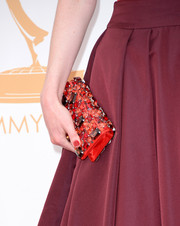 Just like her dramatic dress, Michelle's gemstone clutch boasted different shades of red.