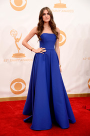 Allison kept her look classic in a strapless, corset gown in a striking blue hue.
