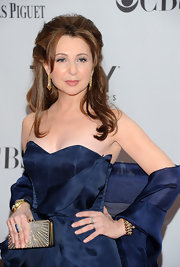 Donna paired her strapless navy dress with a 1940's diamond and 18-karat gold cuff.