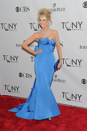 Christie shows off her enviable figure at the Tony Awards in a sky blue taffeta gown.