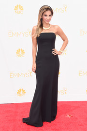 Liz Hernandez was all about sleek elegance in this strapless black column dress during the Emmys.
