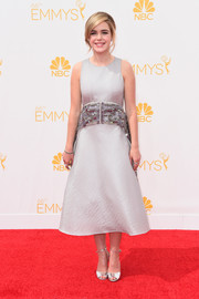 For the Emmys, Kiernan Shipka made an ultra-elegant choice with this silver Antonio Berardi cocktail dress featuring a heavily embellished sash.