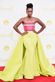 The 'Mad Men' actress amped up the drama on the red carpet in a neon illusion gown for the 2014 Emmy Awards.