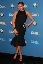 Taraji P. Henson paired her dress with trendy black slim-strap sandals.