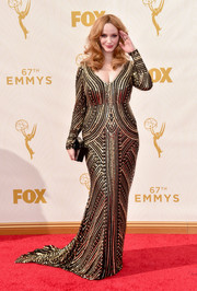Christina Hendricks glittered up her voluptuous figure in a beaded gold and black gown by Naeem Khan for the Emmy Awards.