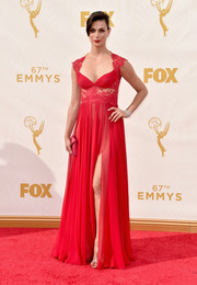 Morena Baccarin worked the Emmys red carpet in a lingerie-inspired red lace-panel gown by Reem Acra.