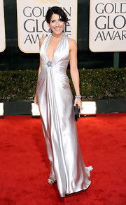 Lisa looks old Hollywood glam in a floor length deep plunging silver gown.