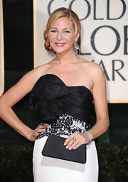 Jennifer Westfeldt paired a black satin clutch with her strapless gown for a classy look during the Golden Globes.